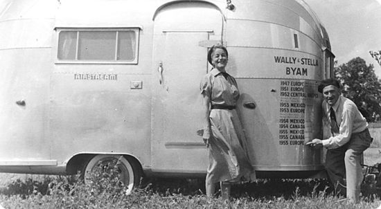 Wally Byam and his wife Stella, posing with an Airstream trailer in 1955