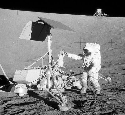 Apollo 12 landed 200 yards away from Surveyor 3. Astronaut Pete Conrad is seen here inspecting the Surveyor to see how it's held up to its long exposure to the rigors of space.